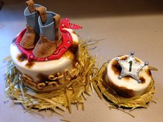 Babies first birthday cake in western theme. Everything is edible including the hay. Boots were hand cut and embossed.