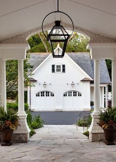 Through the Porte Cochere (or simply a very lovely breezeway?) and on to the Garage with Guest House, by Wade Weissman Architecture. Porte Cochere, Detached Garage Designs, Mansion Homes, Garage Double, Haus Am See, Gas Lanterns, Breezeway, Carriage House, Exterior Lighting