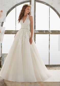 2017 Designer Wedding Dresses and Bridal Gowns by Morilee. Lace and Tulle Wedding Gown with DiamantŽ Beading Cascade Down the Halter Neckline and Bodice.
