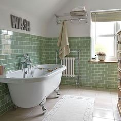 Green tiled bathroom with rolltop bath | Bathroom decorating | Ideal Home | Housetohome.co.uk | WASH sign