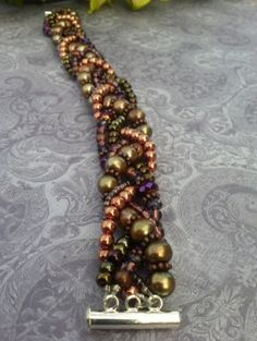 Beaded Braided Bracelet by suzanneshores Sassy Girl Jewelry.... i love these colors! by longyly