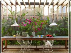 paisagismo e pergola - Jack, a Brazilian terrier, is at home in a São Paulo garden room designed by Isay Weinfeld; vintage iron-wire chairs are pulled up to a florist's worktable. Rustic Outdoor Spaces, Outdoor Rooms, Outdoor Gardens, Indoor Outdoor, Outdoor Decor, Outdoor Dining Chairs, Outdoor Tables, Dining Area, Balcony Chairs