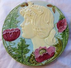 Hungarian Majolica Plate with Lady Head and Poppies