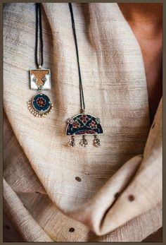 Two of our stunning silver pieces from 'अर्क' collection... #shopnow #handmadeinindia #handcrafted #chandi #silver #pendants #kaaladhaaga #ajrakh #wood #naturaldyes #khadi #tussar #dupatta #productshoot #earthy #raw #indianjewelry #dhruvsingh #floral #handmadejewelry #socialdesignproject #indianart #indiancraft #accessories