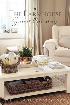 beige and white living room ; white furniture, baskets, long off-white drapes