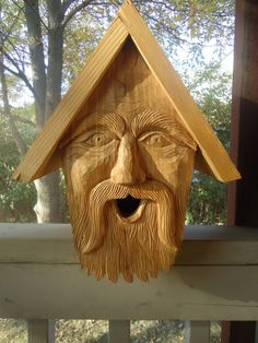Hand made cedar birdhouse, perfect for indoor or outdoor use, complete with a custom carved face.via Etsy.