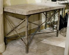 19th century French marble top table with a wrought iron base