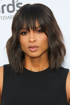 Since sweaty summer has come to an end, now is the perfect time to try out bangs. Cho suggests a '70s-inspired bang like Ciara's that is shorter at the centermost part of your bangs and gradually gets longer toward your temples. This type of  bang frames most face shapes in a really nice way, she says.