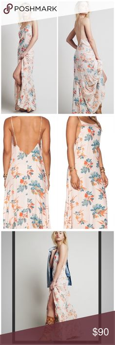 "Free people floral star chasing slip dress New with tags.   Size L.    Easy  breezy floral maxi slip featuring a low scoop back. 100% Rayon. Color: Hibiscus Combo Measurements For Medium I found online  Bust 38"" Length: approx (over) 60"" shoulder to hemline Free People Dresses Maxi"