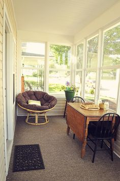 Enclosed Front Porch with dropleaf table. To think a front porch could be a nice space...