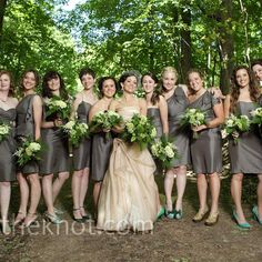 Are these gray dresses what you're thinking of? I think they would fit in perfectly if we had gold sashes!