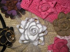 You have likely seen the fabric flowers popping on everything from clothing to accessories. Now, the new version of the flowers is to make them with zippers. They're easy to make and have a little metallic bling built in.