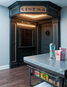 Home Theatre Entrance -  paint the door and add trim/lowered ceiling. Candy shelves, popcorn machine, and mini fridge in opposite wall, instead of box office?