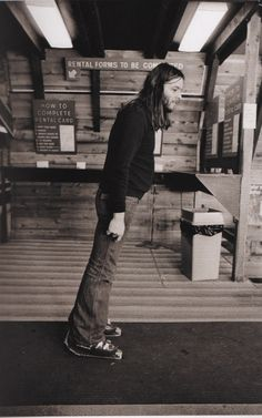 David Gilmour of Pink Floyd trying out some ski boots, 1975.