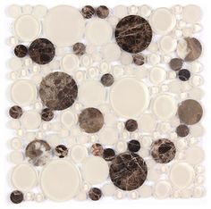 Finish: Polished / Shiny Product Size: 12x12Chip Size: Random Circles Color: Dark Brown / ClearSold By: Square foot (Quantity 1 = 1 sq ft)Dark