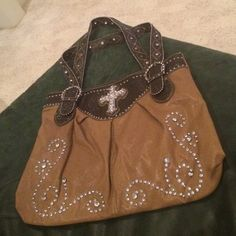 Embellished purse Perfect condition purse with studs on straps and front and a cross emblem Bags