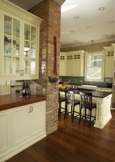 I kinda want to expose the brick chimney that runs through the middle of our house like this one. good idea? bad idea?