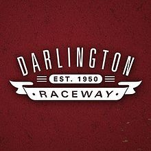 """Darlington Raceway is a race track built for NASCAR racing located near Darlington, South Carolina. It is nicknamed """"The Lady in Black"""" and """"The Track Too Tough to Tame"""" by many NASCAR fans and drivers and advertised as """"A NASCAR Tradition."""" It is of a unique, somewhat egg-shaped design, an oval with the ends of very different configurations, a condition which supposedly arose from the proximity of one end of the track to a minnow pond the owner refused to relocate."""