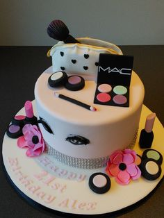 Mac cosmetics 21st birthday cake, make up bag with pink flowers and hand drawn eyes with false eyelashes