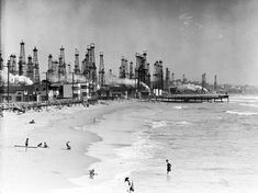 People frolic along the Playa del Rey beach, the skyline dominated by oil derricks. Courtesy of the California Historical Society Collection, USC Libraries.