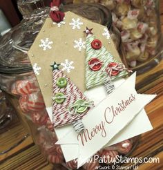Stampin' Up! Tree Punch wrapped with Baker's Twine on Christmas tag.  Display at Founder's Circle 2014