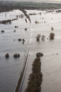 The main railway line through Somerset near Bridgwater is now completely underwater in places. | 27 Staggering New Pictures Of The Somerset Levels Floods