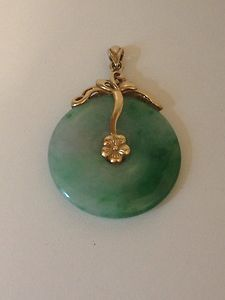 Calm cool and collected this serene pendant features cut out jade jade pendant mozeypictures Gallery