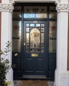 Decorative Edwardian front door painted dark blue with elegant stained glass. Traditional brass door furniture Decorative Edwardian front door painted dark blue with elegant stained glass. Black Front Doors, Wooden Front Doors, Painted Front Doors, Glass Front Door, Front Door Farrow And Ball, Dark Doors, Glass Doors, Front Door Porch, Front Door Entrance