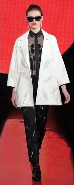 Holly Fulton Sheer Feather Shirt £350 Peek-a-boo sheer silk enhanced by feather details adds a naughty edge to ladylike attire.