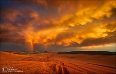Rainbow Storm Sunset night over the Palouse by  Zack Schnepf