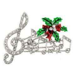 This Christmas-themed brooch features 55 inlaid round cut stones. Styled with a treble clef, musical notes and a decorative holiday bow, this brooch has a highly polished finish.