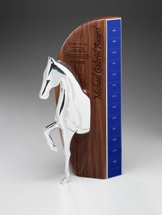 Michael Gabriel Award | Custom shaped trophy with select timber backing | Design Awards