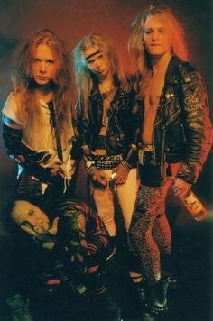 Crashdïet lineup (2000-2002). In rear, Tobias Forge, Thomas Daun and David Hellman (R.I.P.) Gustaf Lindström (GRGA) is crouching in front. Tobias used the name Mary Goore in tribute to Gary Moore.