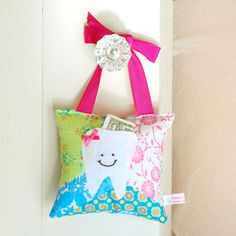 Tooth Fairy Pillow for a Girls Room in Pink, Lime and Turquoise Patchwork Print. $18.00, via Etsy.