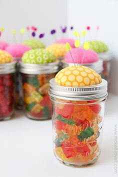 Turn a regular old canning jar (or any other kind of a jar) into a pin cushion.  And then fill it with buttons, pins, bobbins, clothing labels, or CANDY!