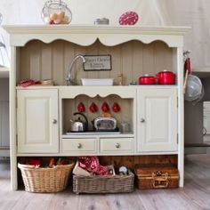 Tutorial on how to make a kids play kitchen like this one from junk furniture - so easy!