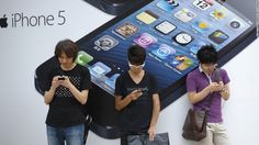 People stand outside a store in Tokyo before the launch of the iPhone 5. Based on first-day orders, the iPhone 5 became the fastest-selling device Apple has released.