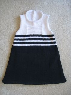 """Ravelry: Starboard Shift (платье ребенка) модель Мишель Мак-Кри [   """"Starboard Shift is a modern take on the classic sailor's dress. It is knit from the bottom up, with a folded lower hem. It has an A-line silhouette, with the front and back worked separately. There is a back button band with a 2 button closure."""",   """"Ravelry: Starboard Shift (child"""
