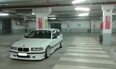 White BMW e36 touring on OEM BMW Styling 32 wheels