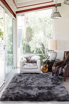 Stylish And Elegant Sheepskin Rug Ideas For Living Room Decoration Rugs In Living Room, Decor, Living Room Decor, Carpet Design, How To Clean Carpet, Living Room Carpet, Home, Grey Sheepskin Rug, Sheepskin Rug