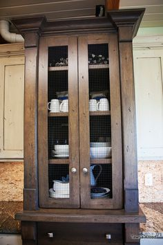 Contrasting chicken wire hutch in Tawna Allred's modern country kitchen.