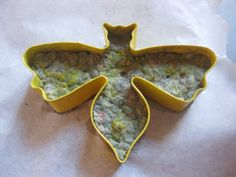 Gifts that grow - wet, shredded newsprint with seeds embedded. Shape in cookie cutter, then give away.