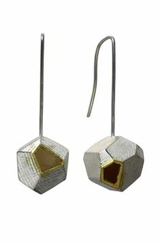 Liaung Chung-Yen faceted shapes in sterling silver and 18K yellow gold.