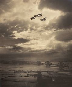 Biplanes over the Forth Bridge and South Queensferrry, circa 1920.