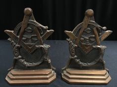 PAIR OF SOLID BRASS MASONIC BOOKENDS MEASURING 8 INCHES IN HEIGHT.