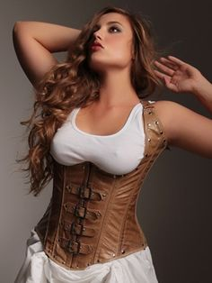 Vivienne Steel Boned Underbust Corset. Crafted in soft tan leather with steel boning throughout for the ultimate in structure and support. Pair with a white tank or blouse, bloomers or a peasant skirt for a complete steampunk or prairie look. Please note: Leather will arrive with a distressed look. Perfect styling for steampunk and time period ensembles. Gorgeous corset, got The Want!
