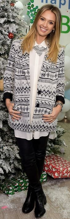Who made  Jessica Alba's silver jewelry and black print coat?