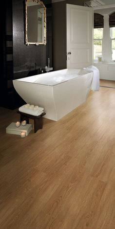 Bathroom fitted with Chestnut Oak luxury vinyl tile flooring from the Cavalio Conceptline range.