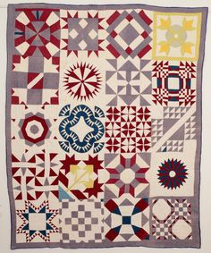 Sampler Quilt: Circa 1890 displaying 20 different patterns in mauve and gray. Stella Rubin Antiques