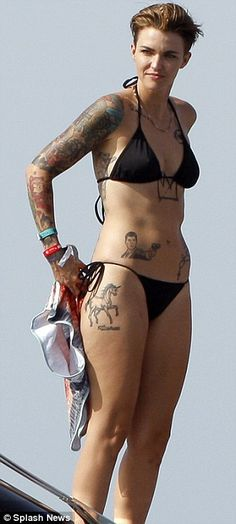 Hot hot hot: Ruby flaunted her never-ending colourful tattoos in the two-piece swimsuit